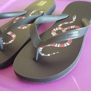 0ce354d46 Gucci Shoes - Authentic Gucci Kingsnake Printed Black Flip Flops